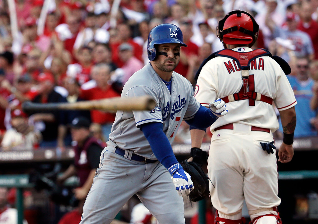 . Los Angeles Dodgers\' Nick Punto throws his bat in front of St. Louis Cardinals catcher Yadier Molina after striking out during the fifth inning of Game 2 of the National League baseball championship series Saturday, Oct. 12, 2013, in St. Louis. (AP Photo/David J. Phillip)