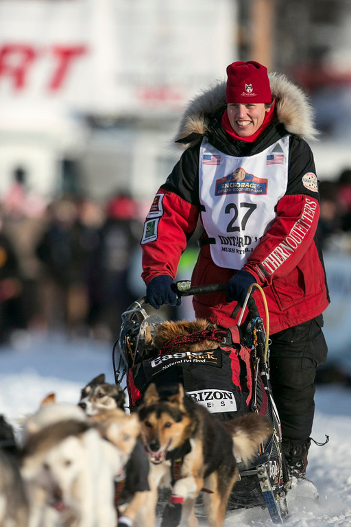 . Aliy Zirkle leaves the start gate at the re-start of the Iditarod dog sled race in Willow, Alaska March 3, 2013. Zirkle finished second place in 2012 and is considered a top contender for the 2013 race.  REUTERS/Nathaniel Wilder