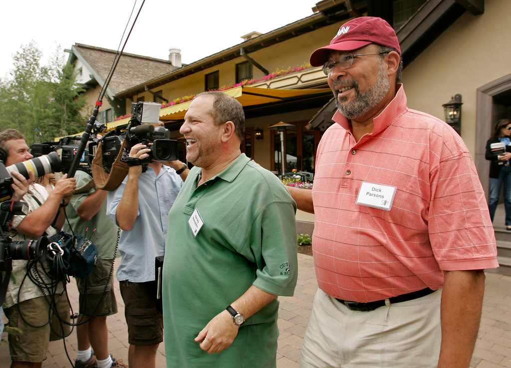 . Harvey Weinstein, co-chairman of The Weinstein Company, center, and Time Warner chairman and CEO Richard Parsons, right, head to lunch at the annual Allen and Co.\'s media conference Thursday, July 12, 2007, in Sun Valley, Idaho.  (AP Photo/Douglas C. Pizac)