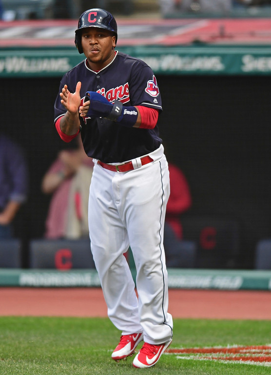 . Cleveland Indians Jose Ramirez celebrates after scoring on a RBI-single by Tyler Naquin in the first inning of a baseball game against the Toronto Blue Jays, Friday, April 13, 2018, in Cleveland. (AP Photo/David Dermer)