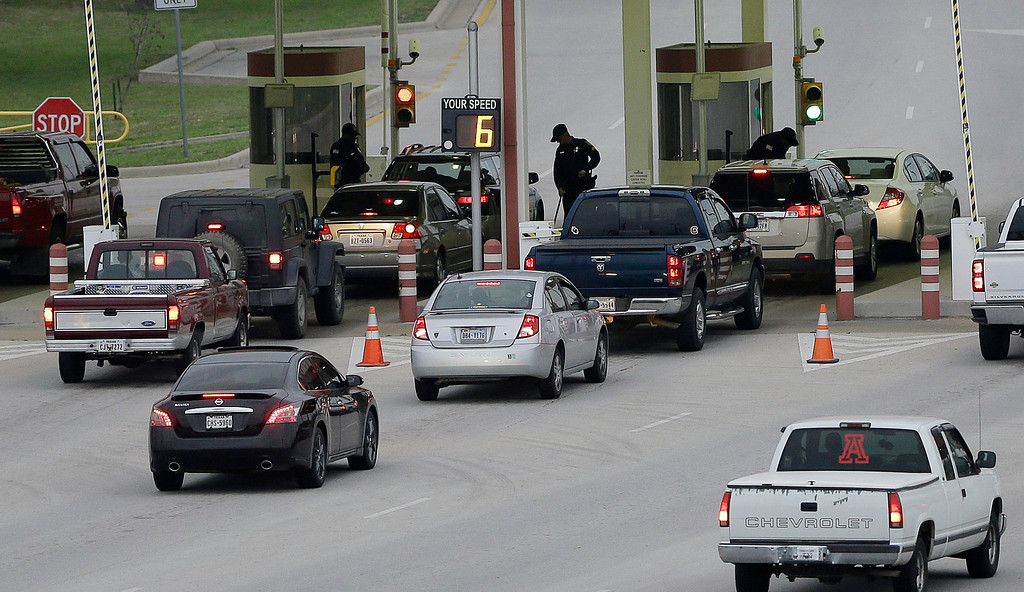 . Security check vehicles as they enter Fort Hood\'s main gate, Thursday, April 3, 2014, in Fort Hood, Texas.  (AP Photo/Eric Gay)