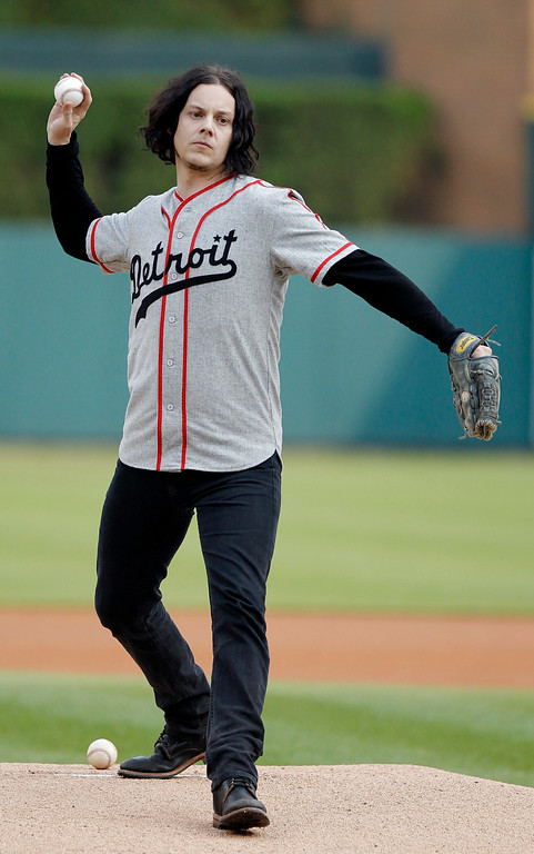 . Musician Jack White throws out the ceremonial first pitch before the Detroit Tigers baseball game against the Chicago White Sox Tuesday, July 29, 2014, in Detroit. (AP Photo/Duane Burleson)