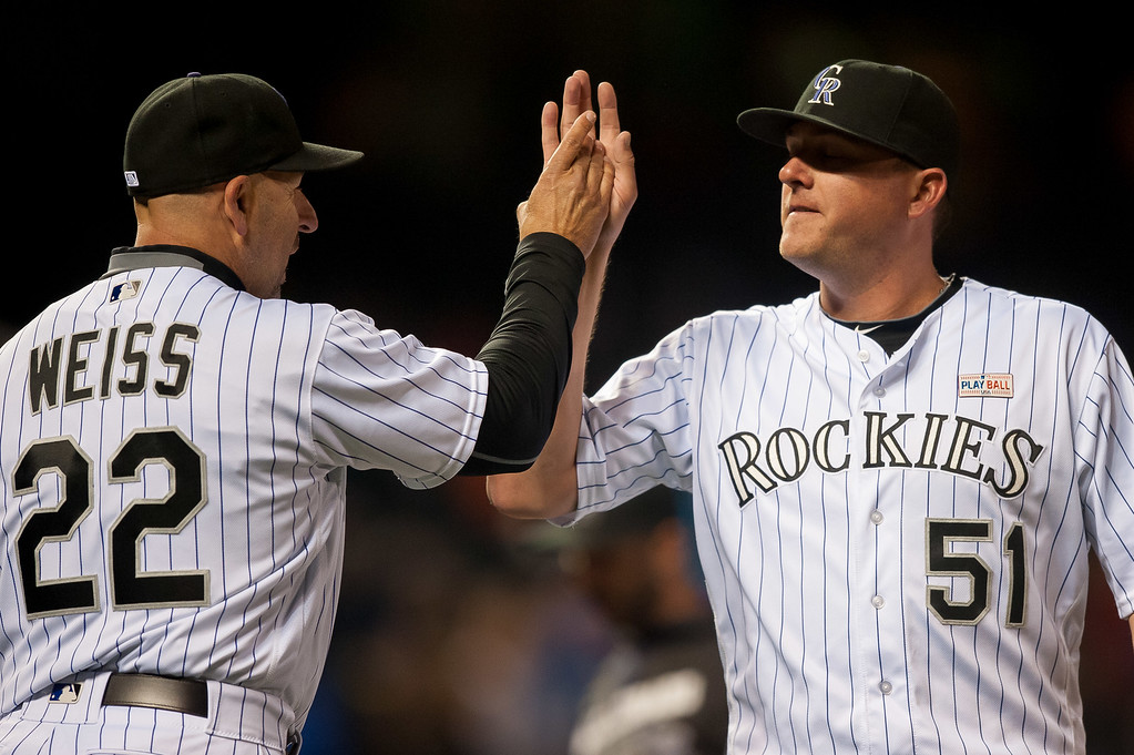 . Jake McGee #51 of the Colorado Rockies celebrates the 7-4 win over the New York Mets with manager Walt Weiss #22   at Coors Field on May 14, 2016 in Denver, Colorado.  (Photo by Dustin Bradford/Getty Images)