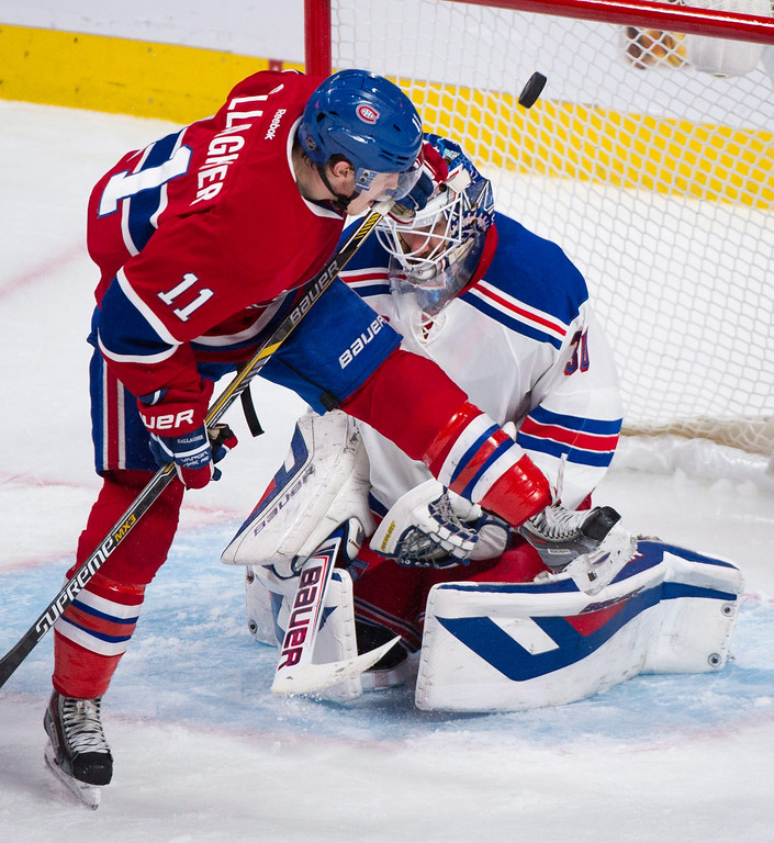 . Montreal Canadiens Brendan Gallagher moves in on New York Rangers\' goaltender Henrik Lundqvist, right, during the third period in Game 2 of the NHL hockey Eastern Conference final Stanley Cup playoff series in Montreal, Monday, May 19, 2014. (AP Photo/The Canadian Press, Graham Hughes)