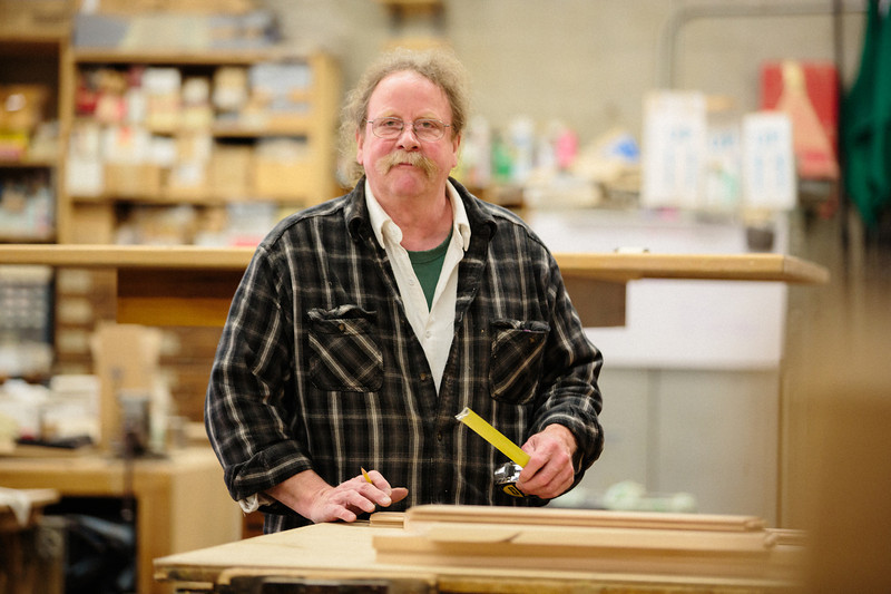 """-What are some of the favorite things you've built on campus? A long time ago, Dann Pierce had a TV studio, and there was a room down in Buckley that was wall-to-wall, floor-to-ceiling cabinets for monitors. It's gone now, but I saw a picture of it the other day and that was really fun to make. Of course the altars I've made were a lot of fun, and the Bible cabinet for the Library – I really liked making that one. One of the most fun projects was when Fr. Corso wanted a solid cherry processional cross that was seven feet tall and three inches thick. I thought, """"That's going to weigh 200 pounds! How am I going to do that?"""" I ended up using four-inch rigid insulation, like you'd put around a foundation, and I cut the foam and put it all together and took cherry veneer and glued it on there. It's still down in the basement of St. Mary's – I saw it down there a few months ago."""