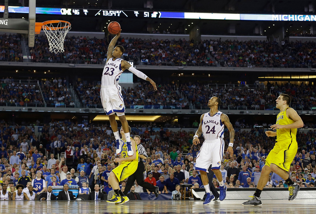. Kansas guard Ben McLemore (23) dunks against Michigan during the second half of a regional semifinal game in the NCAA college basketball tournament, Friday, March 29, 2013, in Arlington, Texas. (AP Photo/Tony Gutierrez)