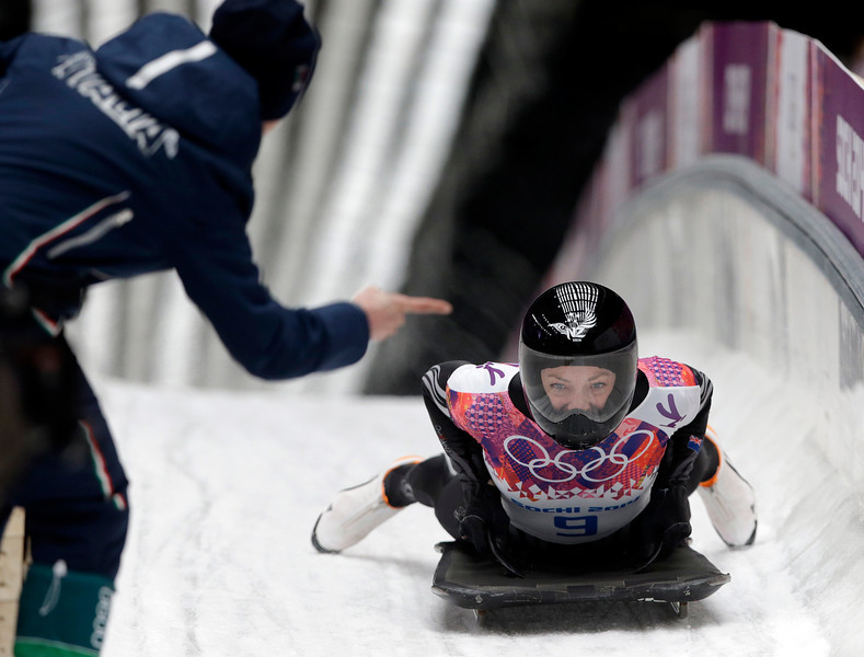 . Katharine Eustace of New Zealand is met by her coach after her final run during the women\'s skeleton competition at the 2014 Winter Olympics, Friday, Feb. 14, 2014, in Krasnaya Polyana, Russia. (AP Photo/Dita Alangkara)