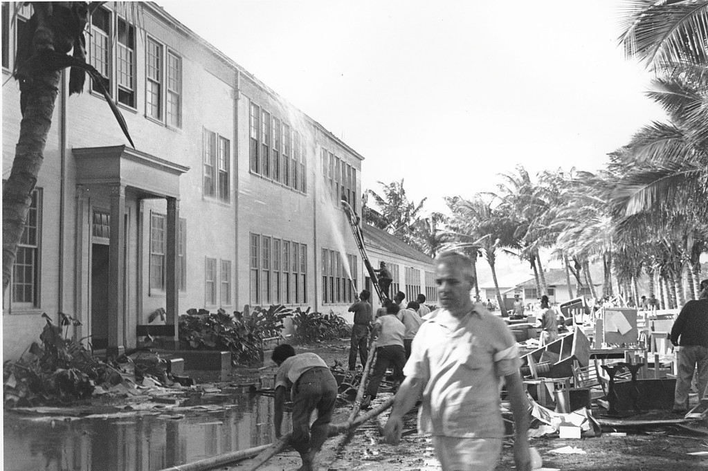 . Rescue workers help evacuate the Lunalilo High School in Honolulu after the roof of the main building was hit by a bomb during the Japanese attack at Pearl Harbor, Hawaii on Dec. 7, 1941.  (AP Photo)