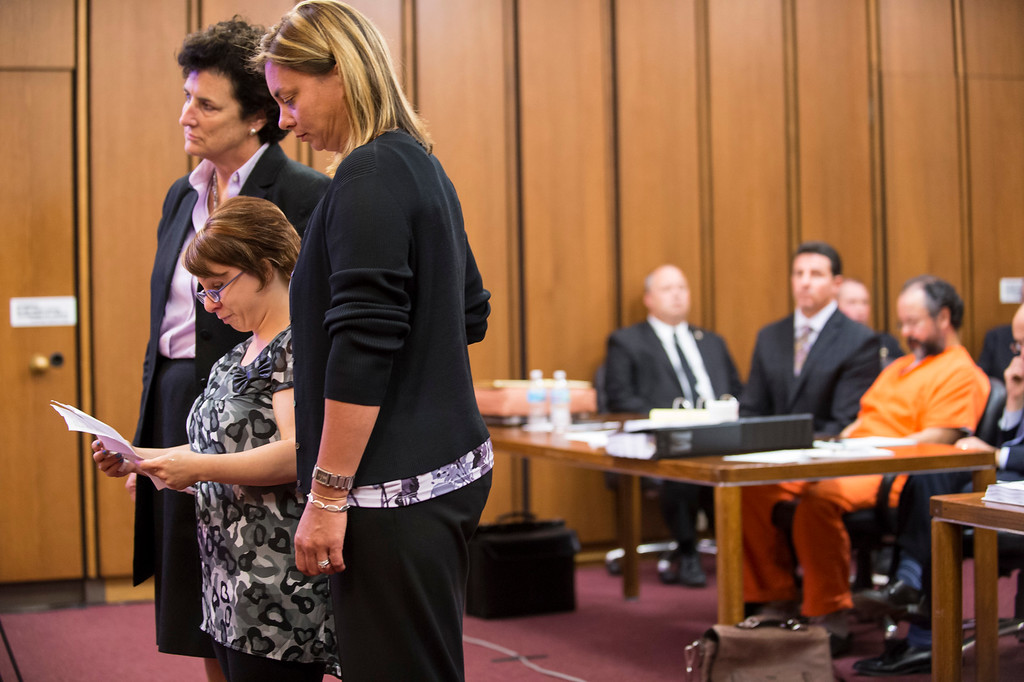. CLEVELAND, OH - AUGUST 1:  Michelle Knight (2L) addresses the court while Ariel Castro (R) listens in the background on August 1, 2013 in Cleveland, Ohio. Castro was in court awating his sentence for abducting three women, including Knight,  from 2002 and 2004 when they were between 14 and 21 years old. The women escaped this past May.  (Photo by Angelo Merendino/Getty Images)