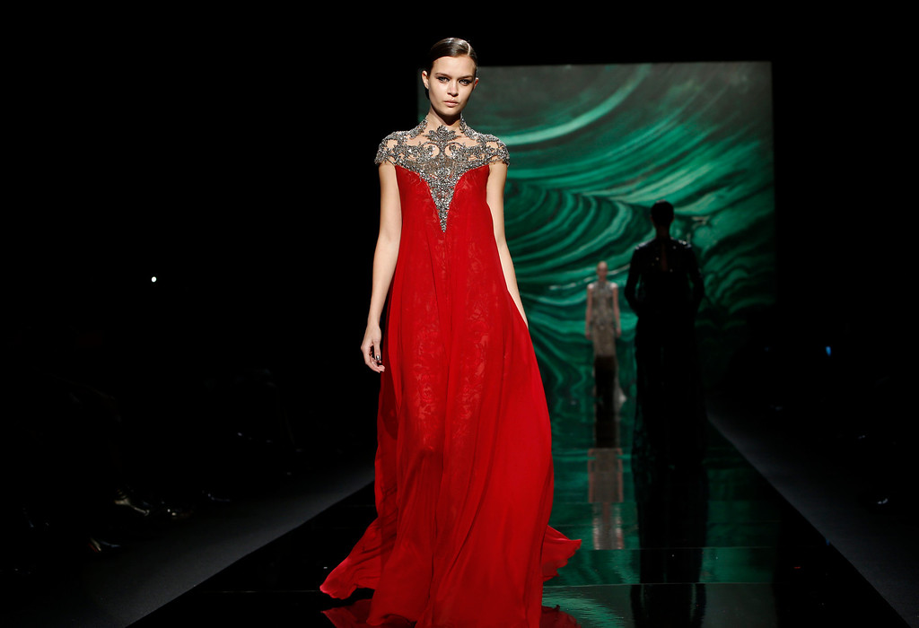 . The Monique Lhuillier Fall 2013 collection is modeled during Fashion Week, Saturday, Feb. 9, 2013 in New York.  (AP Photo/Jason DeCrow)