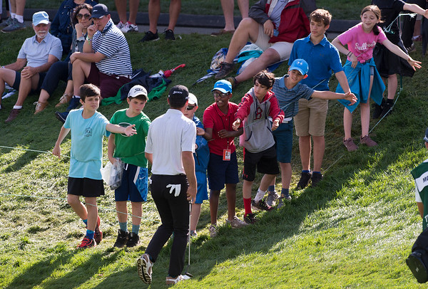 06/21/19 Wesley Bunnell | Staff Qualifying for The Travelers on Friday June 21, 2019. Young fans line up to shake hands with Chip McDaniel as he exits the 18th green.