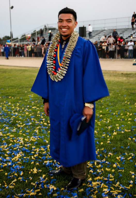 ". Wearing a \""money lei\"" made by his sister, Caesar Ku has officially graduated from John H Francis Polytechnic High School, Sun Valley, Calif., June 7, 2013. Photo: Lynn Levitt."