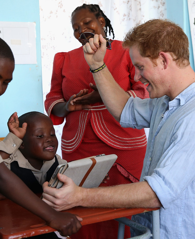 . Prince Harry meets children during a visit to the Thuso Centre for children living with multiple disabilities on December 7, 2014 in Bute-Bute, Lesotho. (Photo by Chris Jackson/Getty Images for Sentebale)