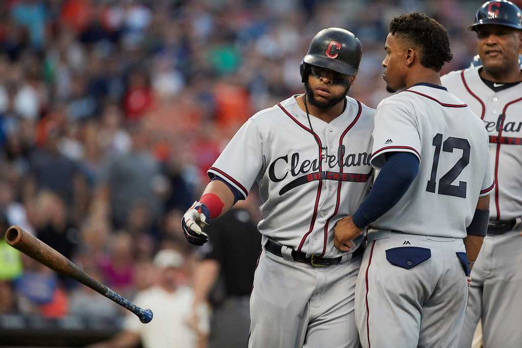 . Cleveland Indians Francisco Lindor, front right, talks to Carlos Santana who was hit by a pitch during the fifth inning in the second baseball game of a doubleheader against the Detroit Tigers in Detroit, Saturday, July 1, 2017. (AP Photo/Rick Osentoski)