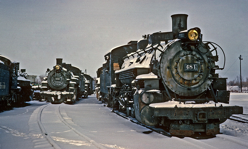December 17, 1961.  Even though the narrow gauge still saw a fair amount of business in 1961, the line of dead engines at Alamosa was a sad sight.  The good news is 50 plus years later the three engines that can be identified here, the 481, 486 and 489 are all back in service on either the Cumbres and Toltec or the Durango and Silverton.