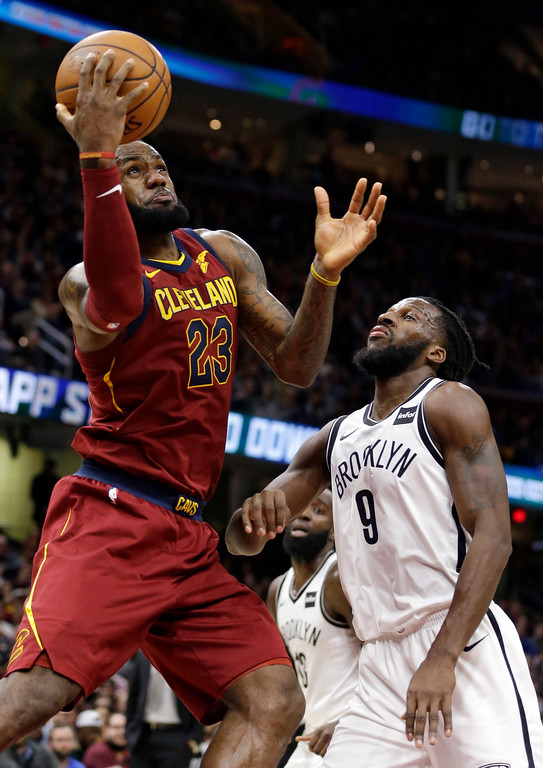 . Cleveland Cavaliers\' LeBron James (23) drives to the basket against Brooklyn Nets\' DeMarre Carroll (9) in the second half of an NBA basketball game, Wednesday, Nov. 22, 2017, in Cleveland. The Cavaliers won 119-109. (AP Photo/Tony Dejak)