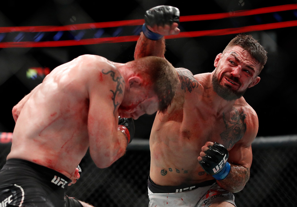 . Mike Perry, right, swings at Paul Felder during a welterweight mixed martial arts bout at UFC 226, Saturday, July 7, 2018, in Las Vegas. (AP Photo/John Locher)