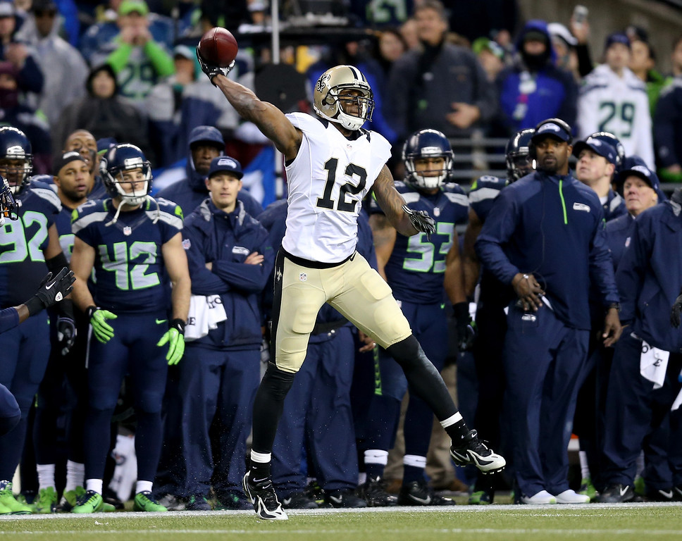 . SEATTLE, WA - JANUARY 11:  Wide receiver Marques Colston #12 of the New Orleans Saints throws an illegal forward pass to end the game against the Seattle Seahawks during the NFC Divisional Playoff Game at CenturyLink Field on January 11, 2014 in Seattle, Washington.  (Photo by Jeff Gross/Getty Images)