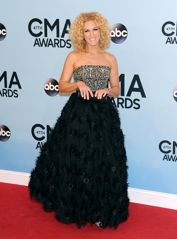 . Kimberly Schlapman, of Little Big Town, arrives at the 47th annual CMA Awards at Bridgestone Arena on Wednesday, Nov. 6, 2013, in Nashville, Tenn. (Photo by Evan Agostini/Invision/AP)