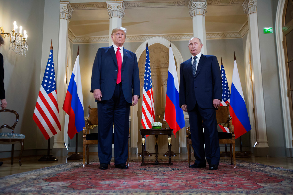 . U.S. President Donald Trump, left and Russian President Vladimir Putin stand together before the start of their meeting at the Presidential Palace in Helsinki, Finland, Monday, July 16, 2018. (AP Photo/Pablo Martinez Monsivais)