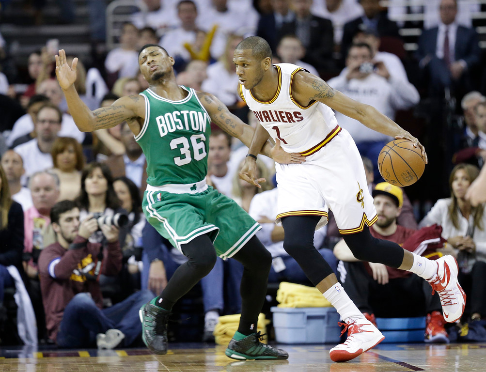 . Cleveland Cavaliers\' James Jones (1) drives on Boston Celtics\' Marcus Smart (36) in a first round NBA playoff basketball game Sunday, April 19, 2015, in Cleveland. (AP Photo/Tony Dejak)
