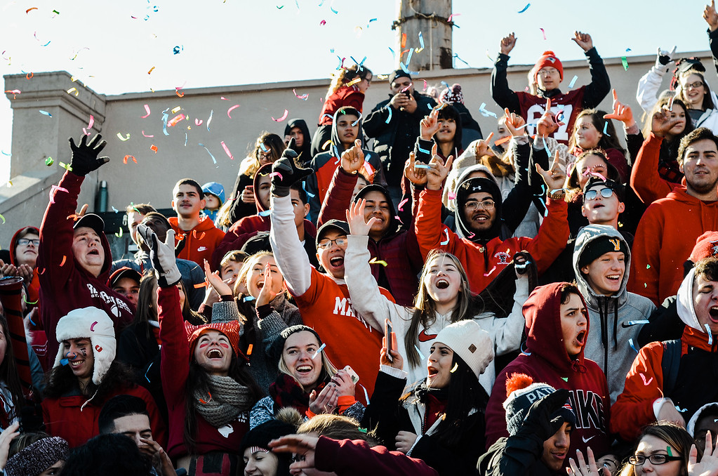 . Fitchburg celebrates winning the annual canned food challenge against Leominster during the 112th meeting of the Thanksgiving game at Crocker Field on Thursday, November 23, 2017. The Red Raiders defeated the Blue Devils 34-21. SENTINEL & ENTERPRISE / Ashley Green