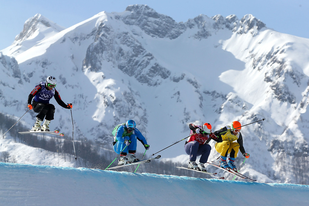 . (L-R) Didrik Bastian Juell of Norway, Thomas Zangerl of Austia, Christopher Delbosco of Canada and Andreas Schauer of Germany compete during the Freestyle Skiing Men\'s Ski Cross 1/8 Finals on day 13 of the 2014 Sochi Winter Olympic at Rosa Khutor Extreme Park on February 20, 2014 in Sochi, Russia.  (Photo by Mike Ehrmann/Getty Images)
