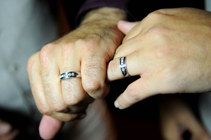 . Ryan Pfeifle and Bradley Weber show off their rings around 12:30 a.m. after they were legally married at their home in Eden Prairie. (Pioneer Press: Sherri LaRose-Chiglo)