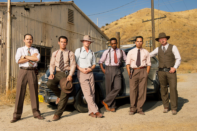 ". This film image released by Warner Bros. Pictures shows, from left, Giovanni Ribisi as Officer Conwell Keeler, Josh Brolin, as Sgt. John O\'Mara, Ryan Gosling as Sgt. Jerry Wooters, Anthony Mackie as Officer Coleman Harris, Michael Pena as Officer Navidad Ramirez and Robert Patrick as Officer Max Kennard in ""Gangster Squad.\"" (AP Photo/Warner Bros. Pictures, Wilson Webb)"