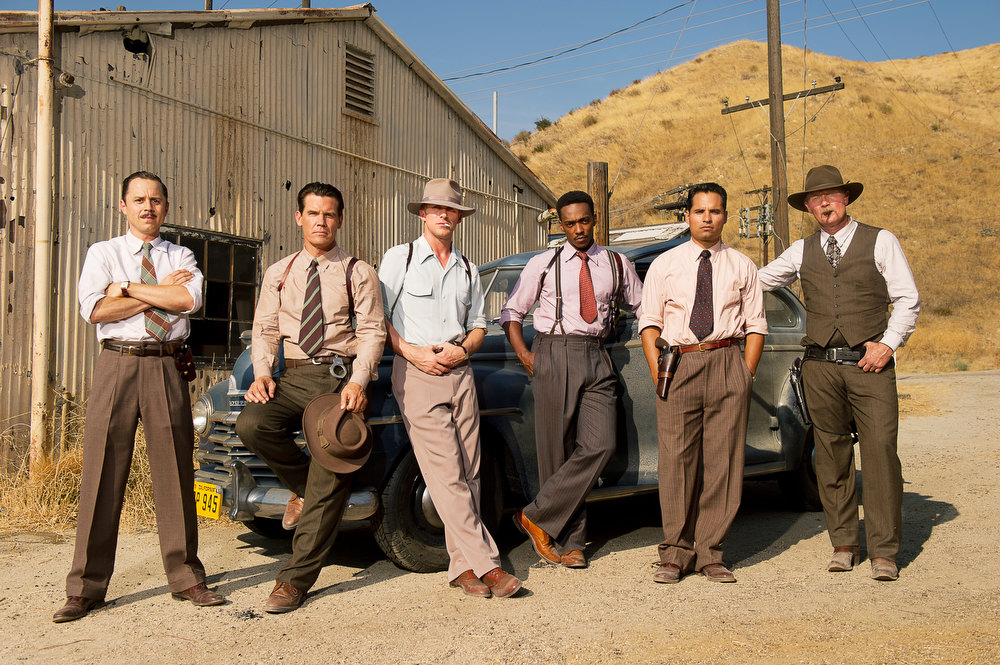 """. This film image released by Warner Bros. Pictures shows, from left, Giovanni Ribisi as Officer Conwell Keeler, Josh Brolin, as Sgt. John O\'Mara, Ryan Gosling as Sgt. Jerry Wooters, Anthony Mackie as Officer Coleman Harris, Michael Pena as Officer Navidad Ramirez and Robert Patrick as Officer Max Kennard in \""""Gangster Squad.\"""" (AP Photo/Warner Bros. Pictures, Wilson Webb)"""