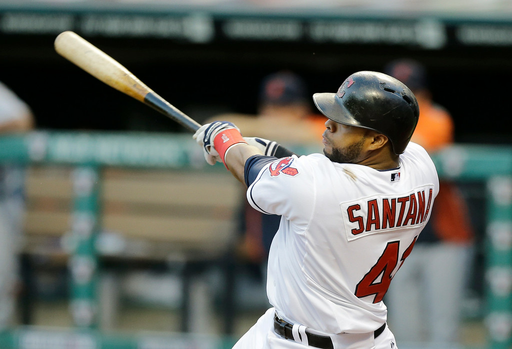 . Cleveland Indians\' Carlos Santana hits a two-run home run off Detroit Tigers starting pitcher Justin Verlander in the first inning of a baseball game, Wednesday, Sept. 3, 2014, in Cleveland. Jose Ramirez also scored on the play. (AP Photo/Tony Dejak)