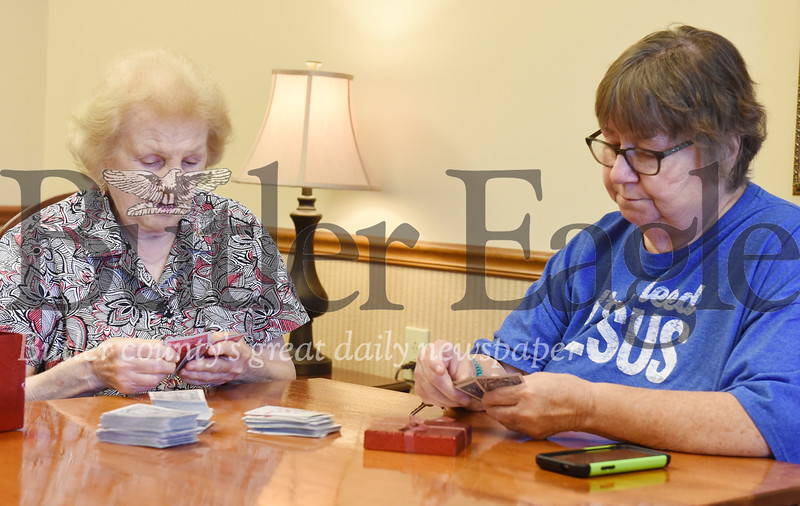 Harold Aughton/Butler Eagle: Nelda Higgins,88, (left) and Marilyn Boyle, 74, play a game of 500 at the Mars Senior Center.
