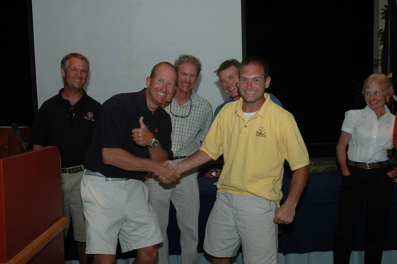 Jon Deutsch winning a Radial Spinnaker from Ernie Deiball of Quantum Sails.