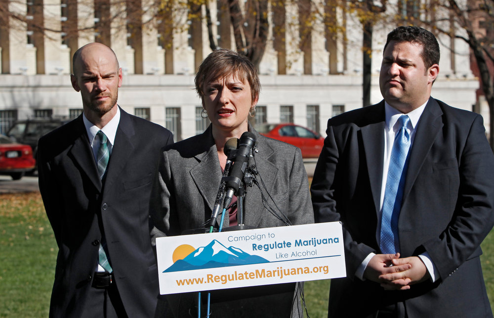 Description of . Betty Aldworth, center,  a director of the Yes on 64 campaign responds to questions about the legalization of marijuana at a news conference  at Civic Center Park in Denver on Wednesday, Nov. 7, 2012. Co-directors Brian Vicente, left, and Mason Tvert, right, listen. Colorado voters passed Amendment 64 on Tuesday legalizing marijuana in Colorado for recreational use. (AP Photo/Ed Andrieski)