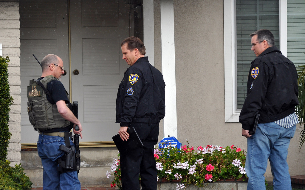 . U.S. Marshals allow Riverside Police Officers into what is believed to be Christopher Dorner\'s mother\'s La Palma home as FBI computer recovery task force investigators armed with a search warrant go through a computer on Friday February 8, 2013. Various agencies have arrived to lend assistance at the home. (SGVN/Staff Photo by Keith Durflinger)