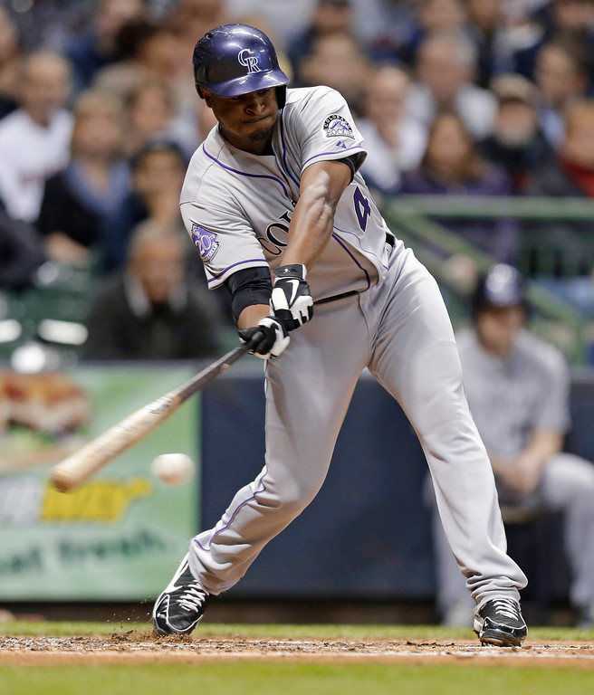 . Colorado Rockies\' Chris Nelson hits an RBI single against the Milwaukee Brewers during the second inning of a baseball game Tuesday, April 2, 2013, in Milwaukee. (AP Photo/Jeffrey Phelps)