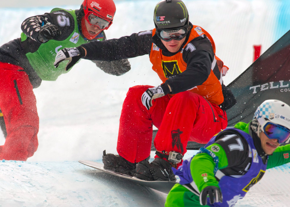 . In this image provided by Nathan Bilow Photography, Nate Holland, center, competes in the snowboard cross team World Cup event in Telluride, Colo., Saturday, Dec. 15, 2012. Holland and partner Seth Wescott won Saturday\'s event. (AP Photo/Nathan Bilow)