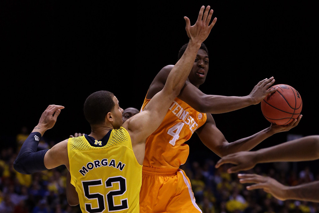 . Armani Moore #4 of the Tennessee Volunteers shoots the ball against Jordan Morgan #52 of the Michigan Wolverines during the regional semifinal of the 2014 NCAA Men\'s Basketball Tournament at Lucas Oil Stadium on March 28, 2014 in Indianapolis, Indiana.  (Photo by Jonathan Daniel/Getty Images)