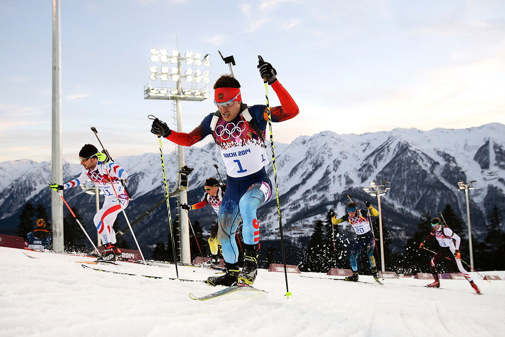 . Russia\'s Yevgeny Garanichev, center, competes during the men\'s biathlon 20k individual race at the 2014 Winter Olympics, Thursday, Feb. 13, 2014, in Krasnaya Polyana, Russia. Garanichev won the bronze medal. (AP Photo/Jae C. Hong)