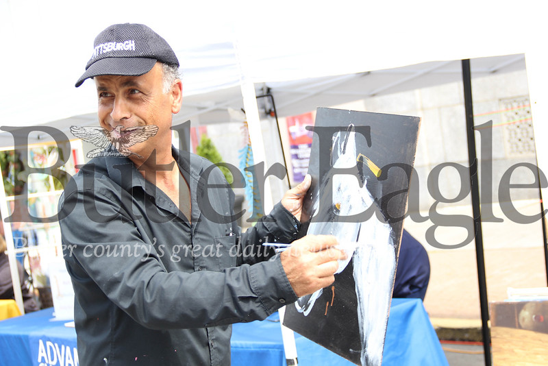Adnan Quedar, 55, is a painter from Florida who was invited to the Butler Italian festival by its organizers after taking part in the Pittsburgh Italian festival. 2018 Lauryn Halahurich/Butler Eagle