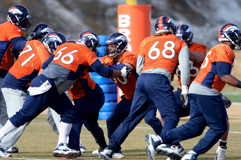. The Denver Broncos offense runs through drills during practice January 16, 2014 at Dove Valley. The Denver Broncos are preparing for their AFC Championship game against the New England Patriots at Sports Authority Field.  (Photo by John Leyba/The Denver Post)
