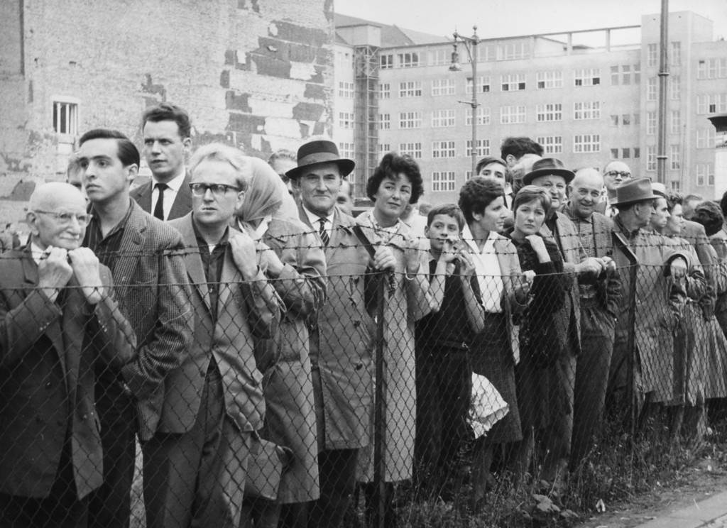 . On a day when the Berlin Wall is open, throngs of West Germans wait for friends and relatives to arrive from the Eastern sector.   (Photo by Three Lions/Getty Images)