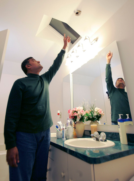 . Srinivasan Nageswaran points to a hole in the ceiling of his bathroom in Freehold Township, N.J., Tuesday, Jan. 9, 2007, that was caused by a meteorite. Nageswaran and his wife, Shankari, have not decided what to do yet with the small meteorite that crashed through  their roof on Jan. 2, 2007. (AP Photo/Mike Derer)