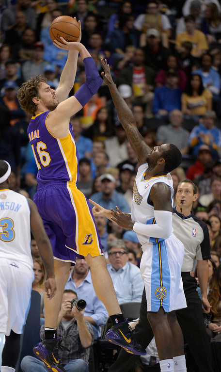 . DENVER, CO - NOVEMBER 13: Los Angeles Lakers center Pau Gasol (16) takes a shot over Denver Nuggets power forward J.J. Hickson (7) during the second quarter November 13, 2013 at Pepsi Center. (Photo by John Leyba/The Denver Post)