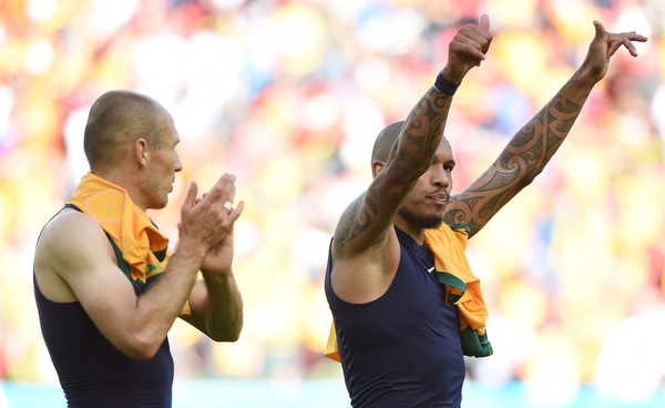 . Netherlands\' midfielder Nigel de Jong (R) and Netherlands\' forward Arjen Robben wave as they leave the pitch after a Group B football match between Australia and the Netherlands at the Beira-Rio Stadium in Porto Alegre during the 2014 FIFA World Cup on June 18, 2014.          (WILLIAM WEST/AFP/Getty Images)