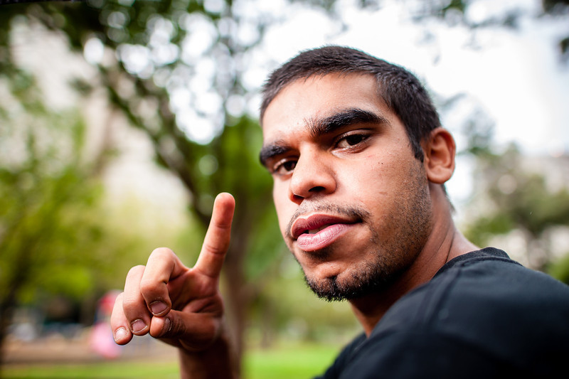 Young Aboriginal Man holding up One Finger