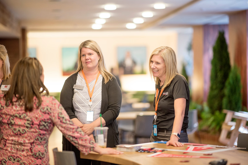 Shari Anderson (center) and Megan Odom (right) enjoy a conversation at Chico State's Alumni Day at Salesforce West on Thursday, May 10, 2018 in San Francisco, Calif. (Jessica Bartlett /University Photographer/CSU Chico)