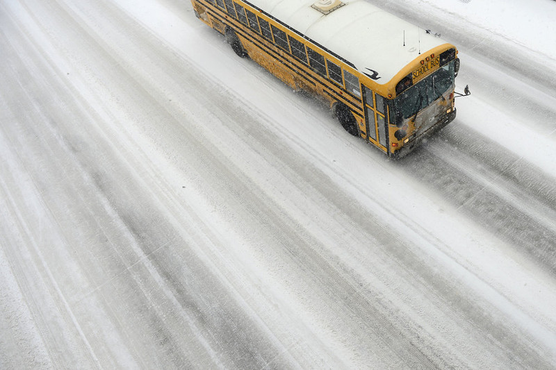 . A Weld County school bus travels on I-25 as seen from the Steele Street overpass. Snow is expected to fall throughout the day. (Photo by AAron Ontiveroz/The Denver Post)