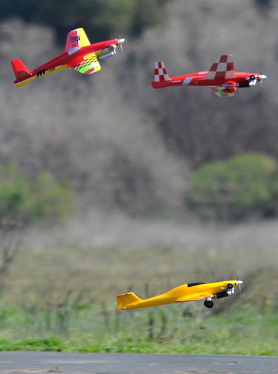 . Aircraft take off from the start line. Dozens of model aviation enthusiasts are participating in the National Miniature Pylon Racing Association\'s Basin Q40 Classic. Pilots are testing their skills at the Sepulveda Basin Recreation Area where they guide their aircraft by remote control around pylons at speeds in excess of 170 mph.Van Nuys, CA 2/23/2013(John McCoy/Staff Photographer)