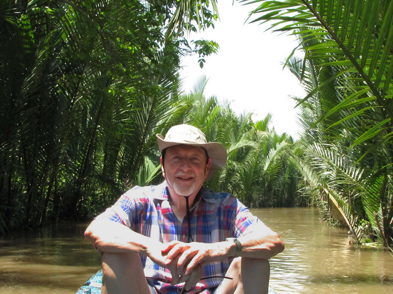 44-Sitting in the prow of the rowboat on the Mekong side channel